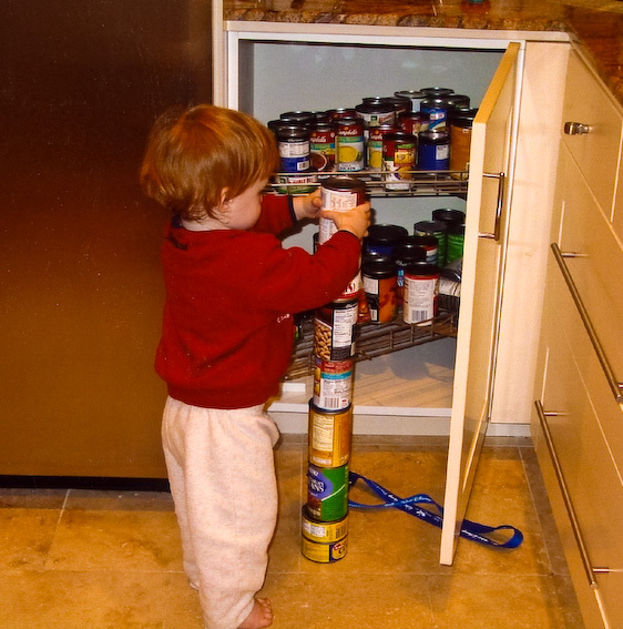 An autistic child shows the compulsive behavior of stacking cans. Research hopes to use sensors to detect signs of autism such as this. (credit: Courtesy of Wikimedia Commons)