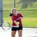 Senior Danielle Rosenfeld charges the net and hits a forehand volley. Rosenfeld won both of her singles matches 8–0.