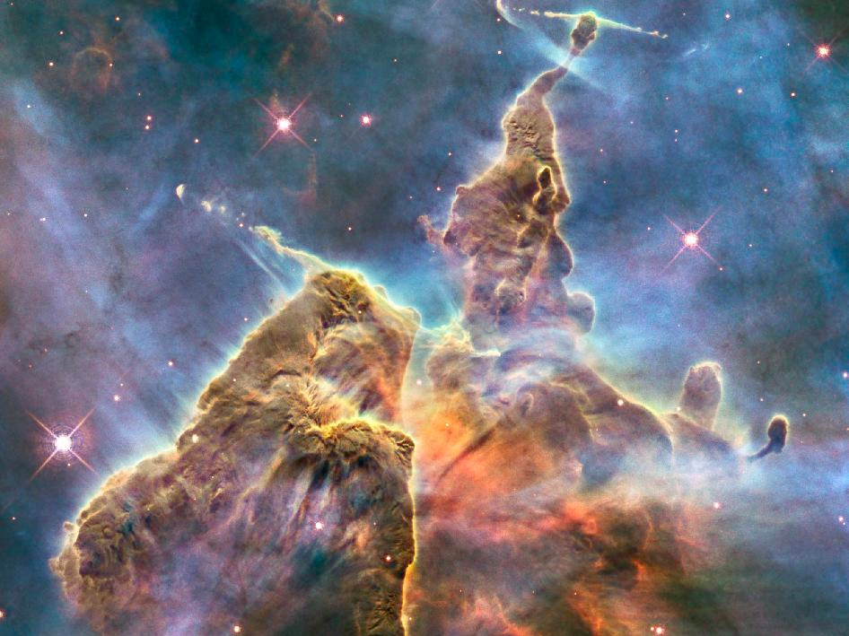This brilliant image shows towers of dust and hydrogen in space. These pillars are three light-years in height. Star formation can be seen by the long, thin jets of gas being emitted from the tips of the clouds. (credit: Courtesy of NASA)