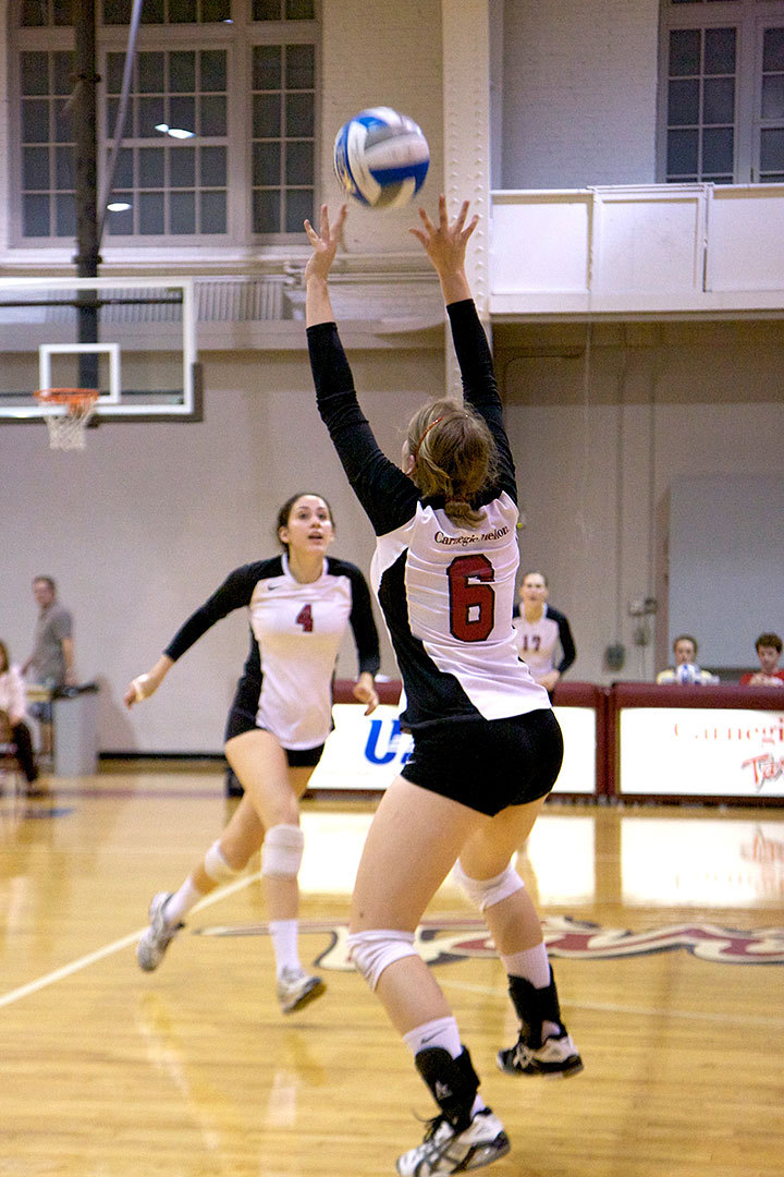 A Tartan player leaps to slam the ball over the net. (credit: Jonathan Carreon/Photo Staff)