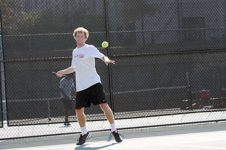 Sophomore Duke Miller winds up to hit a forehand during his singles match against No. 2 Amherst College. The Tartans were swept by the Lord Jeffs 9–0 yesterday afternoon. (credit: Thomas Hofman/Assistant Photo Editor)