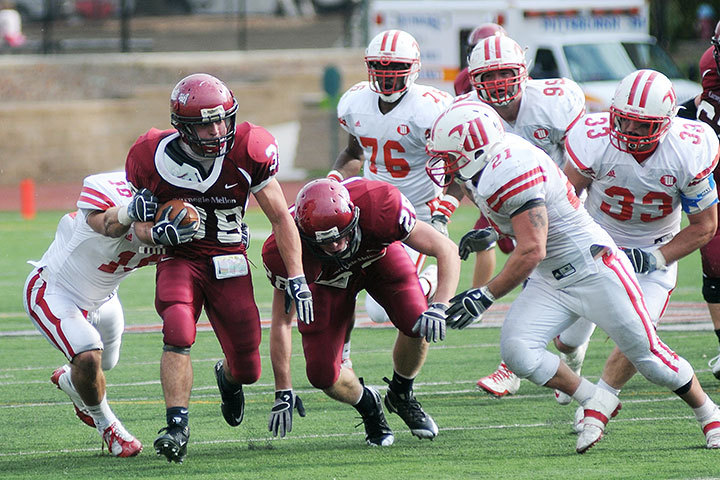 Sophomore running back Jake Nardone sprints up the field while Wittenberg defenders chase after him last Saturday in Gesling Stadium. (credit: Isaac Jones/Comics Editor )