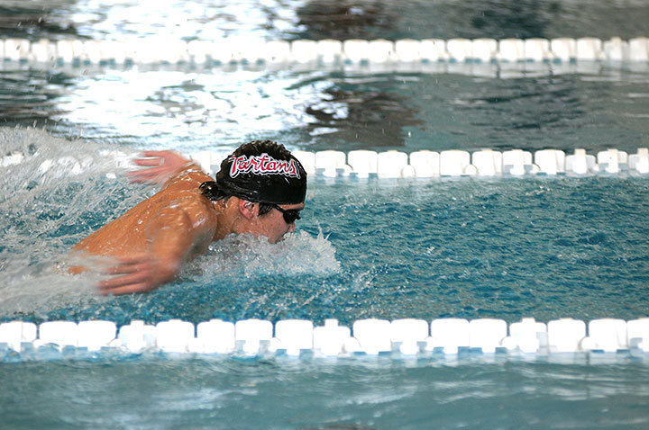 Sophomore Brandon Yee swims the 200-yard butterfly during the swimming and diving team's first home meet against Clarion University.  (credit: Isaac Jones/Comics Editor )