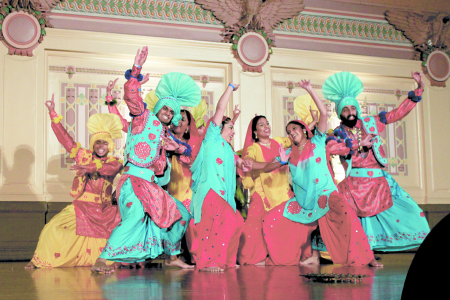 A team performing at Bhangra in the Burgh, hoping to leave with the first-place trophy, strikes a pose. (credit: Alexandre Kaspar | Photo Staff)