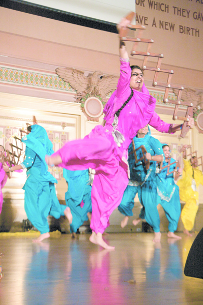 A performer at Bhangra in the Burgh dances on stage at the Soldiers and Sailors Memorial Hall with the hopes of winning the dance competition.  (credit: Jonathan Carreon | Photo Staff)