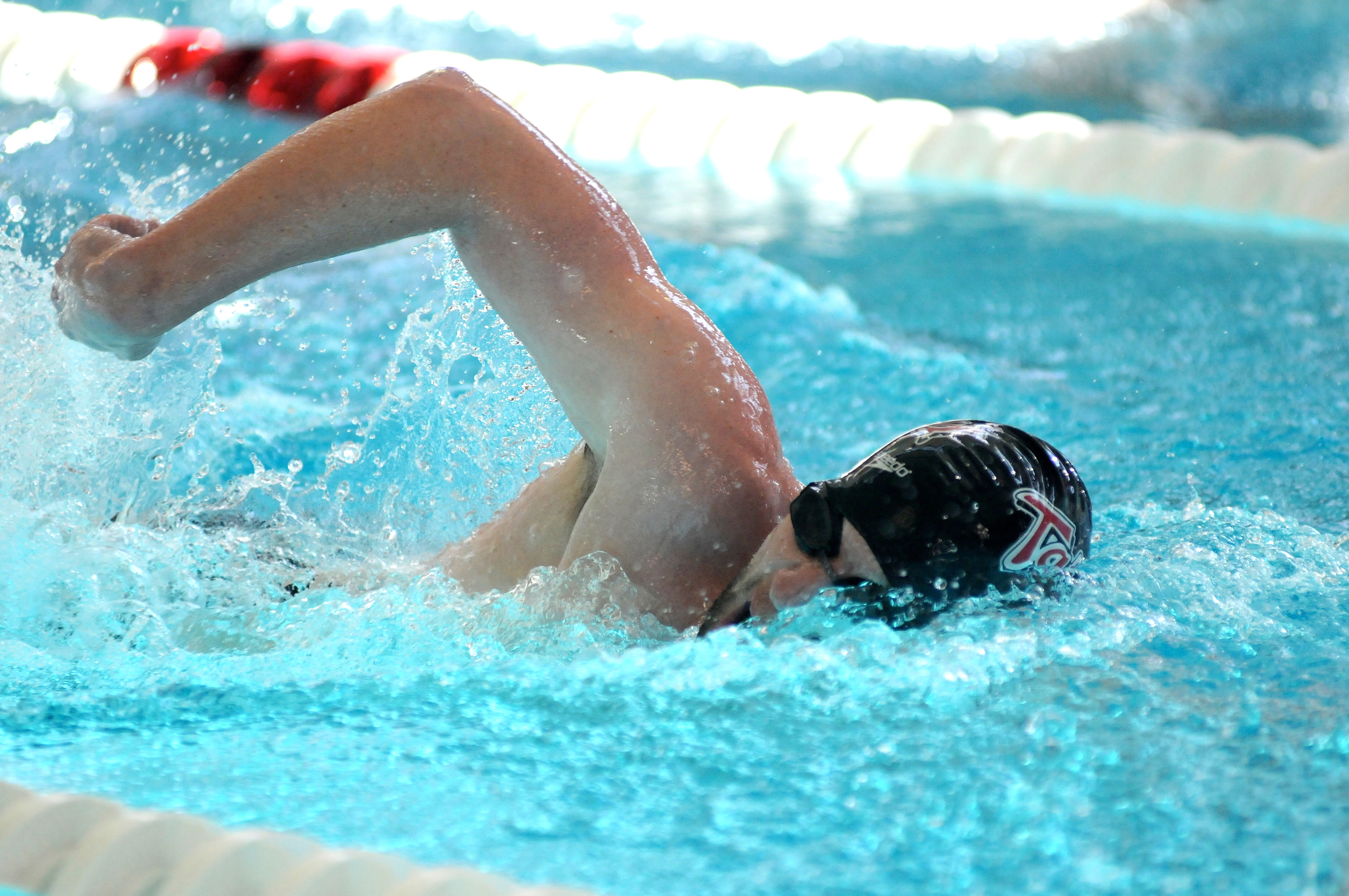 Senior Justin Whaley swims for the Tartans during the meet last Saturday. Carnegie Mellon beat Grove City College, and the men's team won both the 1,000-yard freestyle and the 100-yard butterfly events. (credit: Isaac Jones/Comics Editor )