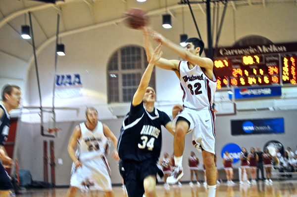 First-year Christian Manoli passes the ball to a teammate. (credit: File Photo)
