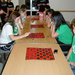 Tartan Olympics participants compete in a game of checkers.