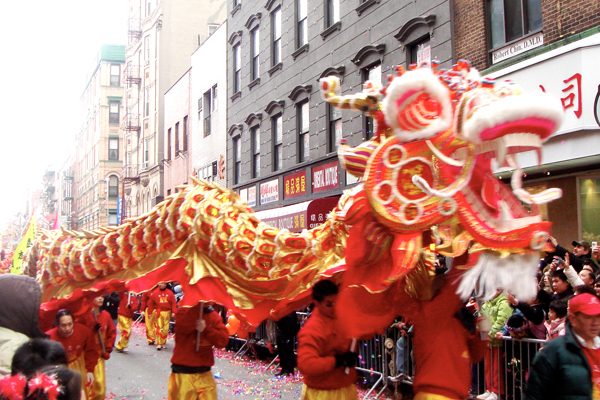 Dragon dances are a common tradition of Chinese New Year celebrations. (credit: Courtesy of Global Jet via Flickr)
