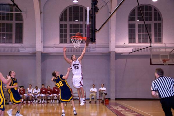 Senior Matthew Pettit (#33) goes up to the hoop. (credit: Jessica Sochol/Photo Staff)