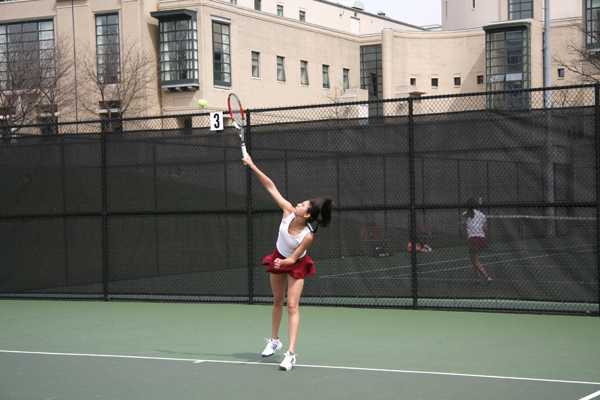 Senior Jennifer Chui hits a serve during a singles match. (credit: File Photo)