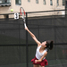 Senior Jennifer Chui hits a serve during a singles match.