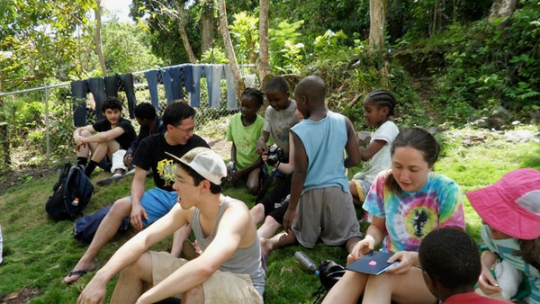 The students who participated in the Mechanical Engineering International Service Learning Experience often interacted with the children in Jamaica, despite cultural and language barriers. (credit: Courtesy of the MechE International Service Learning Trip)