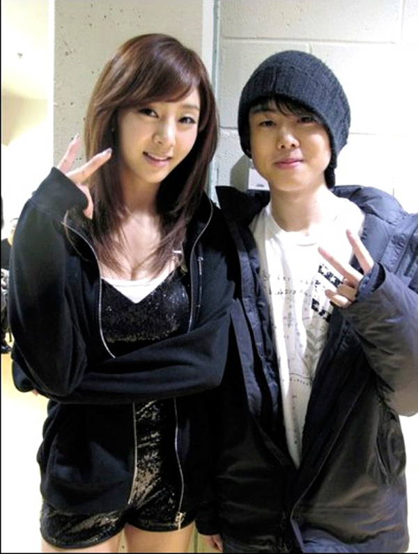 Chris Hong, right, had the opportunity to meet and open for Korean pop singer G.NA, left, as a finalist in the Koreaboo: Cube Auditions 2011. (credit: Courtesy of Chris Hong)
