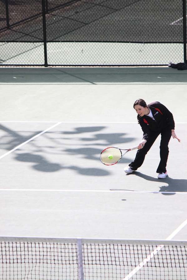 Senior Ashley Herrick hits a forehand volley during a doubles match.  (credit: Alexandre Kaspar/Photo Staff)