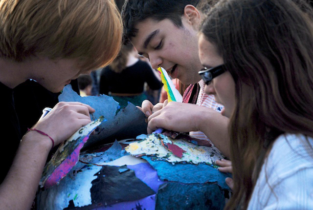 Students examine layers of paint peeled away from the Fence. (credit: Michael Kahn/Editor-in-Chief)