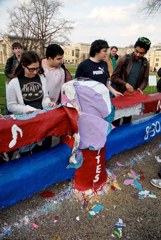 Students surround the damaged portion of the Fence Monday evening. (credit: Michael Kahn/Editor-in-Chief)
