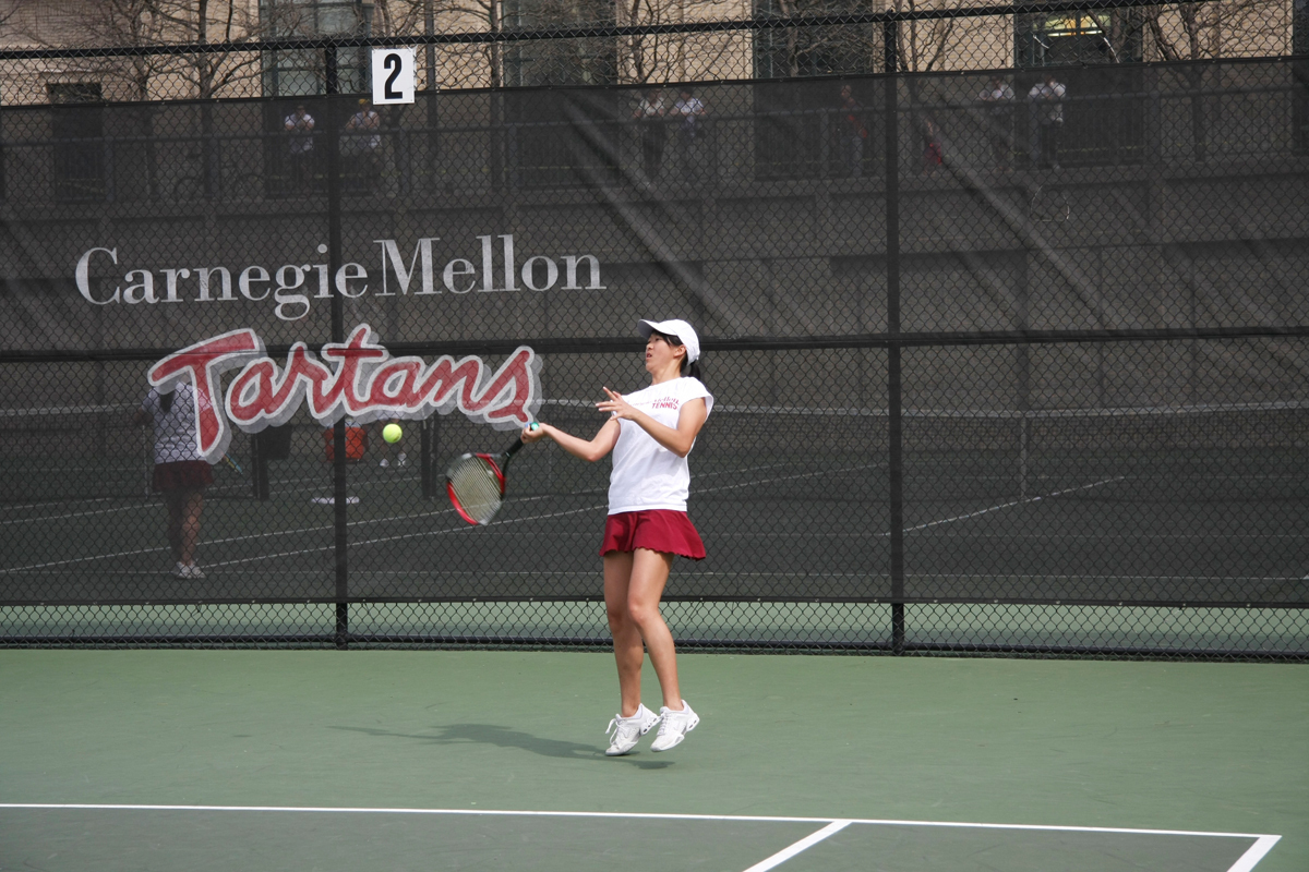 Junior Cze-Ja Tam focuses on the ball while hitting a forehand in her singles match. (credit: File Photo)