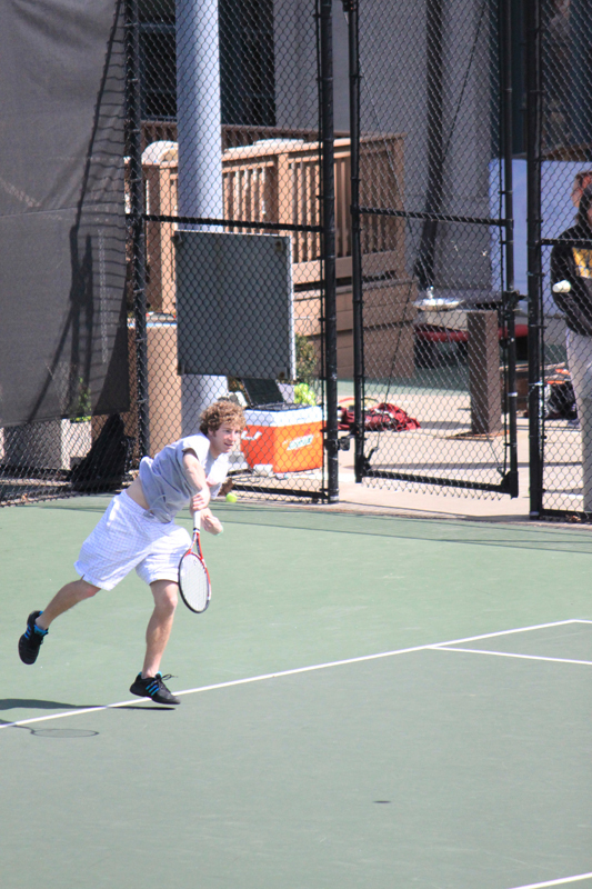 Sophomore Duke Miller follows through on a serve during a singles match. (credit: Alexandre Kaspar/Photo Staff)