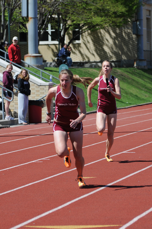 Senior Courtney Baker looks to pass the baton in a relay race. (credit: File Photo)