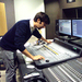 David Grabowski works on the music for the first episode in the studio.