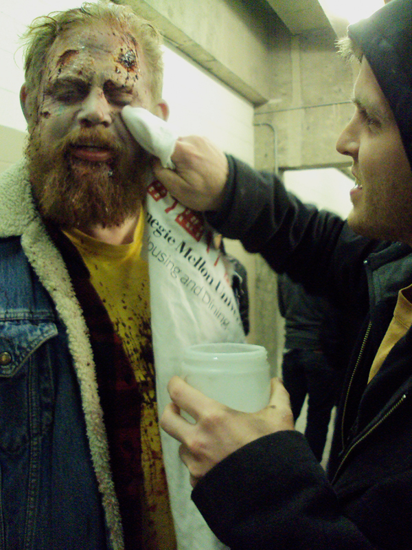 Cast members Oscar Peters is zombified by make-up artist James Krahe. (credit: Courtesy of Yulin Kuang)