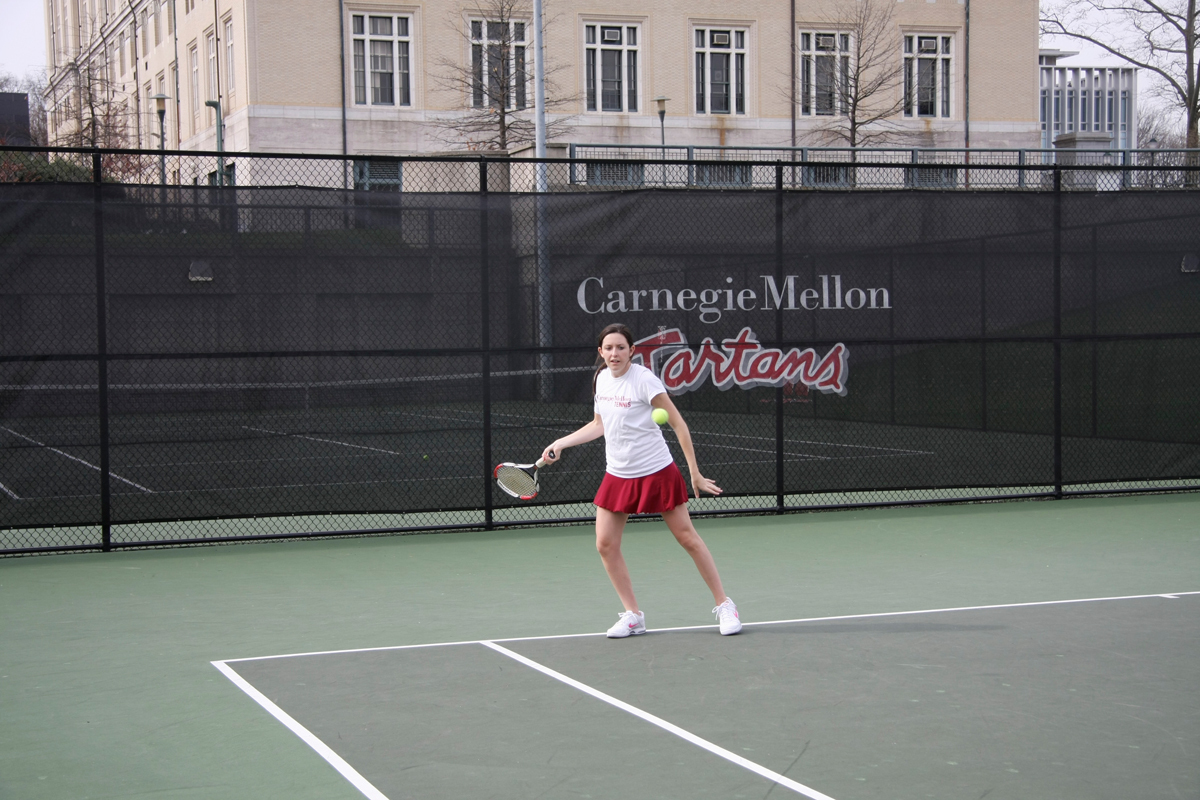 Senior Ashley Herrick sets up a forehand to return the ball. (credit: File Photo)