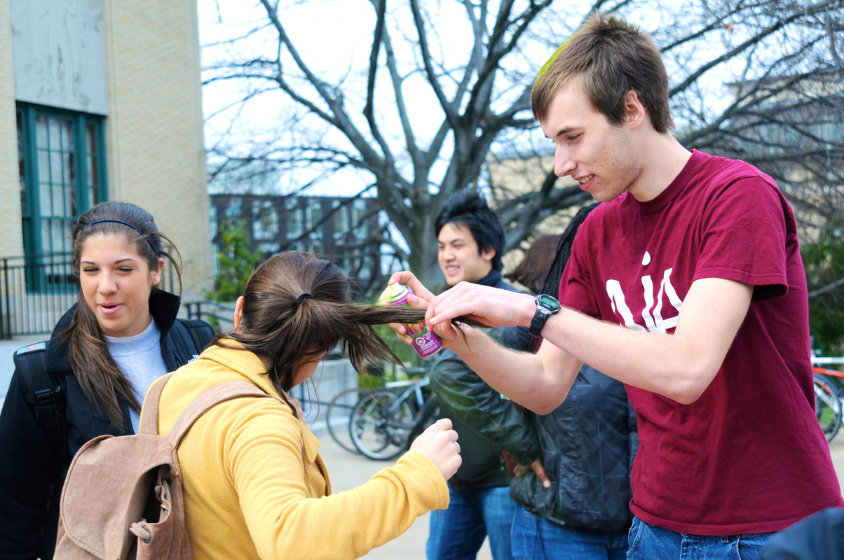 Students spray their hair different colors to raise funds for Japan relief efforts. (credit: Thomas Hofman/Photo Editor)
