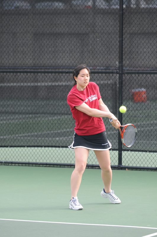 Junior Laura Chen hits a backhand during her doubles match against the University of Pittsburgh. (credit: Alex Webster/ Photostaff)