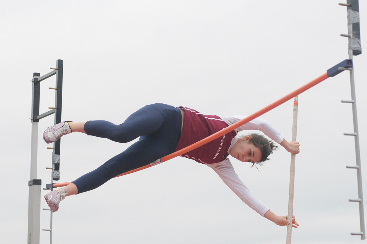 Lisa Marion Garcia attempts to beat the school record for pole vaulting Saturday. (credit: Celia Ludwinski/ Managing Editor)