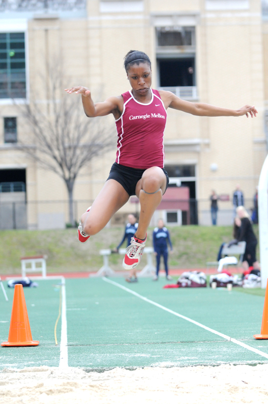 Junior Ivana Moses gets high off the ground as she competes in the triple jump. (credit: File Photo)