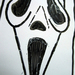 The Scream series murderer, Ghostface, wears a mask of a screaming face.