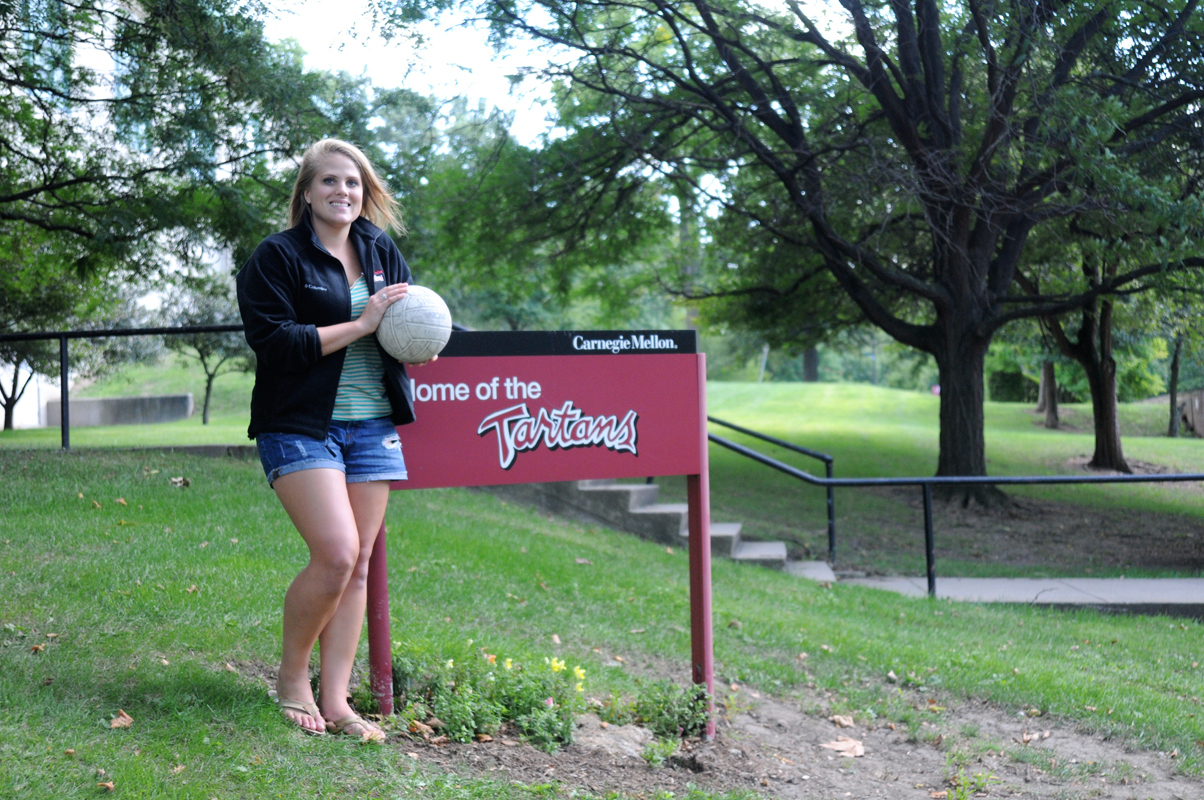 Emily Baddock poses in front of Skibo Gymnasium where the Tartan volleyball team practices and plays. Baddock begins her last season his year. (credit: Tommy Hofman/Photo Editor)