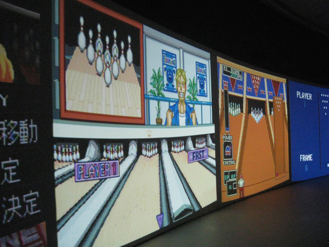 """Beat the Champ,"" an installation featuring bowling video games, was on display at The Curve in the Barbican Art Gallery in London. Cory Arcangel hacked the games to continually loop rounds where the bowler fails to score. (credit: Courtesy of nicksarebi via Flickr)"