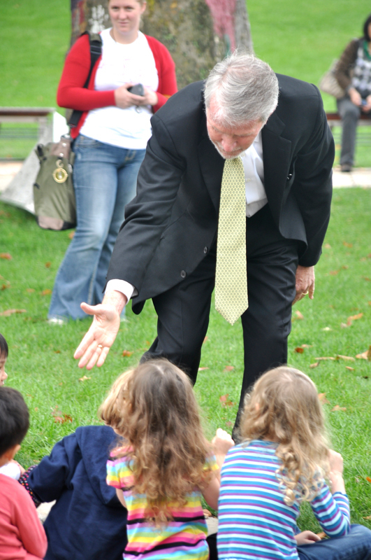 Lane shakes the hands of children at the announcement.  (credit: Alan Vangpat/Layout Staff)