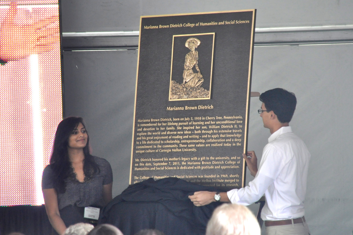 Two students unveil the plaque honoring Dietrich's mother. H&SS was renamed in honor of Dietrich's mother, and the plaque will be installed in Baker Hall. (credit: Alan Vangpat/Layout Staff)