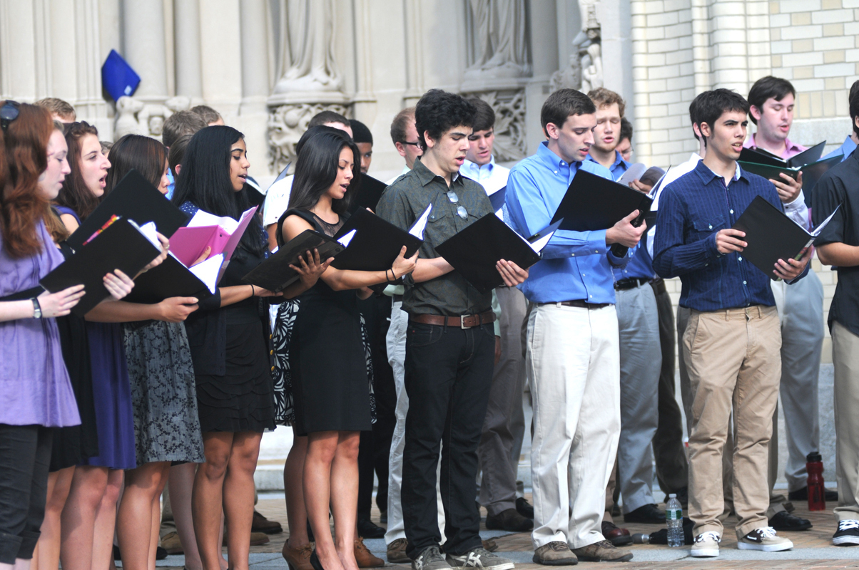 The Carnegie Mellon choir, directed by Robert Page, sang a selection of solemn and patriotic songs following Cohon's speech at the ceremony on Sunday. (credit: Thomas Hofman/Photo Editor)