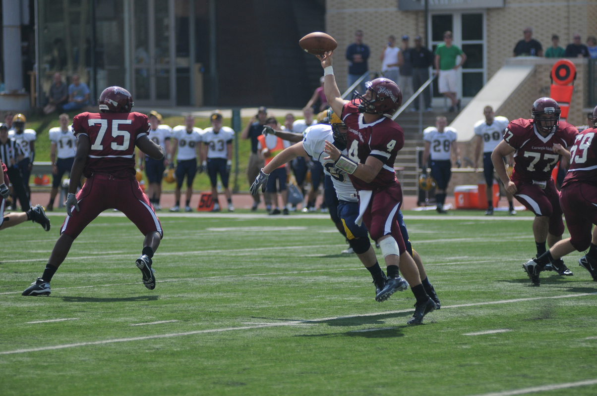 Sophomore quarterback Rob Kalkstein heaves a pass under pressure. (credit: Celia Ludwinski/Operations Manager)