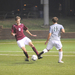 Forward Max Tassano dribbles around St. Vincent's midfielder Daniel Moore in the second game of the CMU Invitational. Tassano scored one goal in the game, his first of the season.