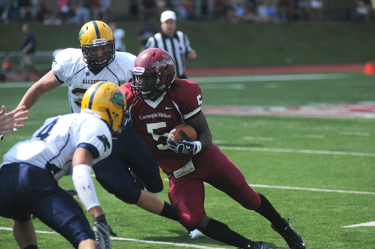 Junior running back Robert Blanks cuts through the defense on a sweep. (credit: Celia Ludwinski/Operations Manager)