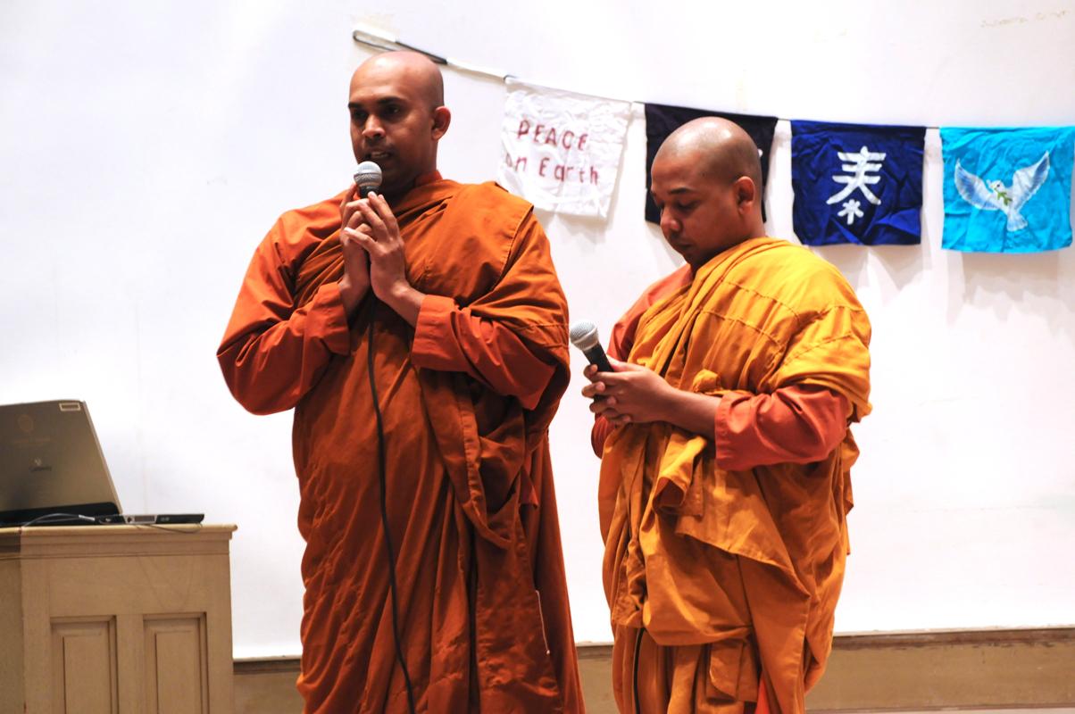 Buddhist monks of the Baha'i faith recite prayers and readings at Sunday's ceremony. (credit: Thomas Hofman/Photo Editor)