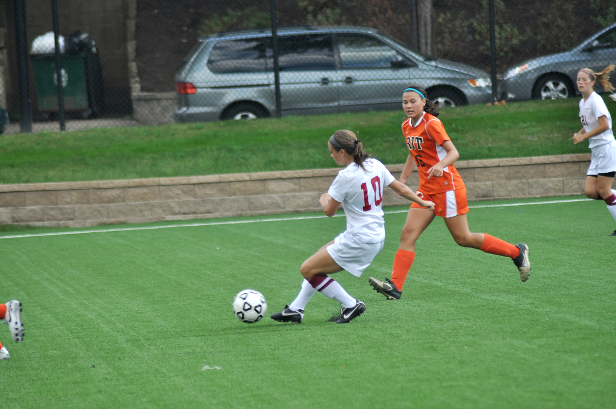Junior Brianna Magill maintains Tartan possession of the ball from onlooking opponent. (credit: File Photo)