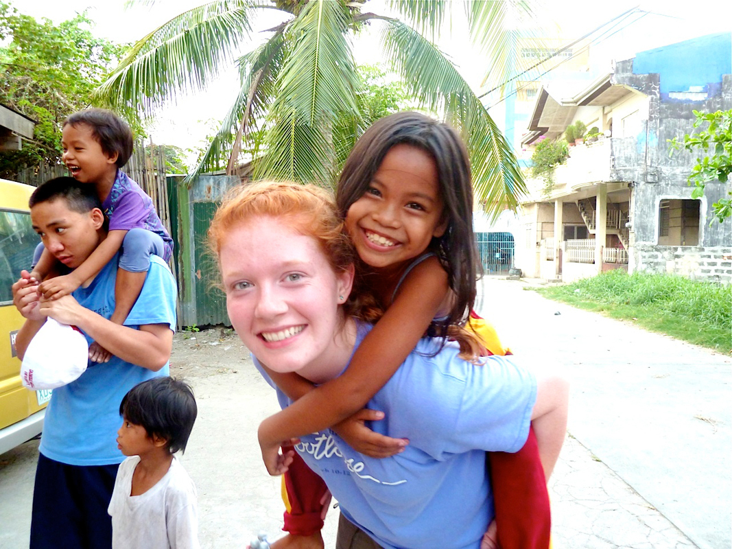 """Zakrajsek spent the majority of her stay in the Phillippines playing with local children. Despite a significant language barrier, the children showed their affections for her and called her _Ate_, Tagalog for  """"sister."""" (credit: Sarah Zakrajsek/Personnel Manager)"""