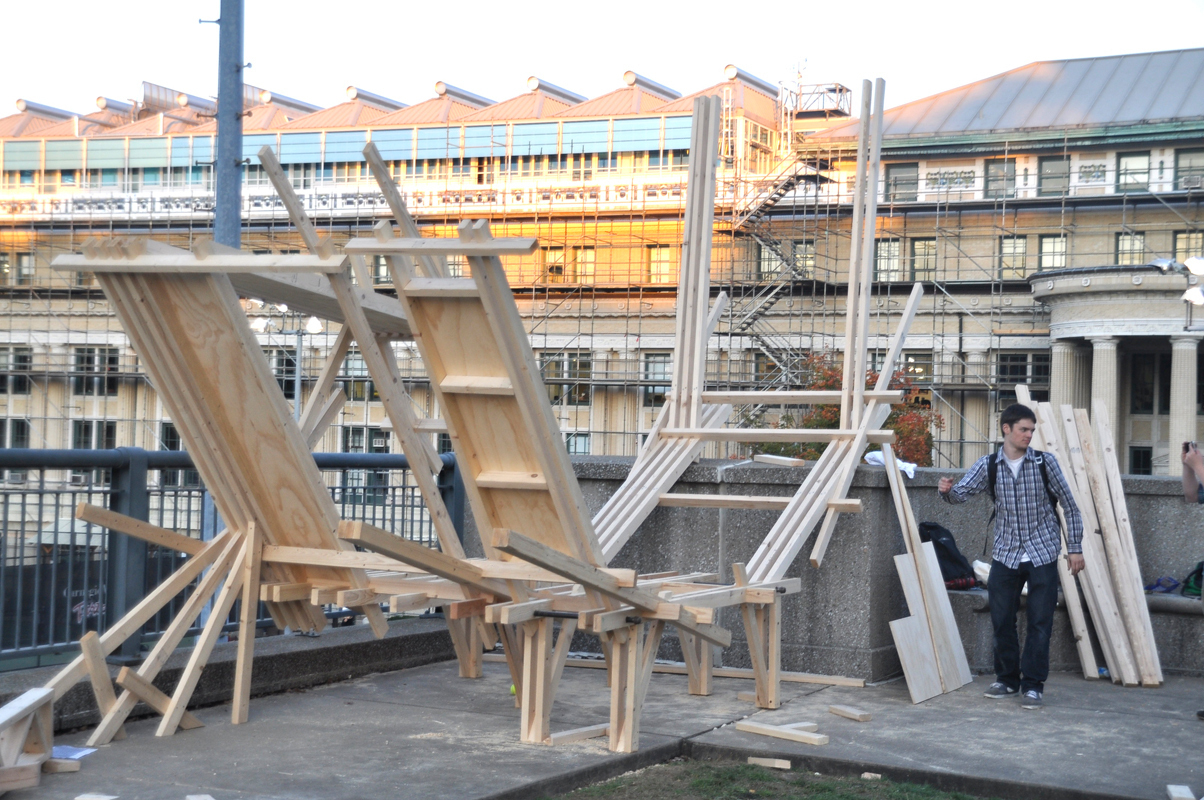 Second-year architecture students build a structure to shelter the Fence for a class project. (credit: Alan Vangpat/Layout Staff)