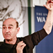 Performance artist Stelarc shows his left-arm ear implant during a keynote talk at the University of Warwick last June.