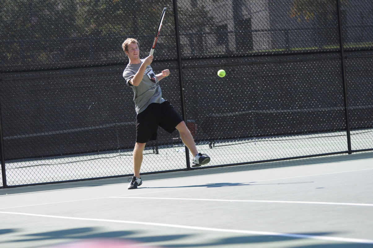 Junior Duke Miller hits a forehand from the baseline. (credit: Thomas Hofman/Photo Editor)