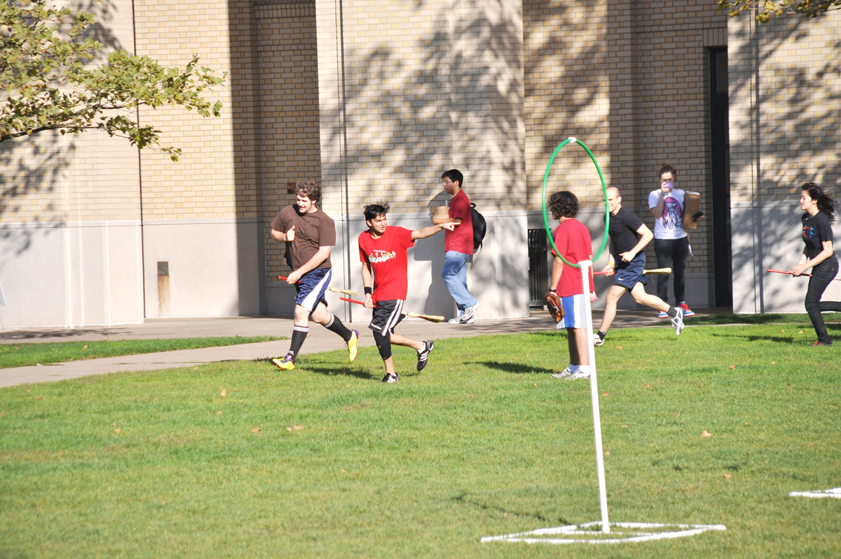 The Carnegie Mellon Quidditch team holds practice on the Cut. (credit: Alan Vangpat/Layout Staff)