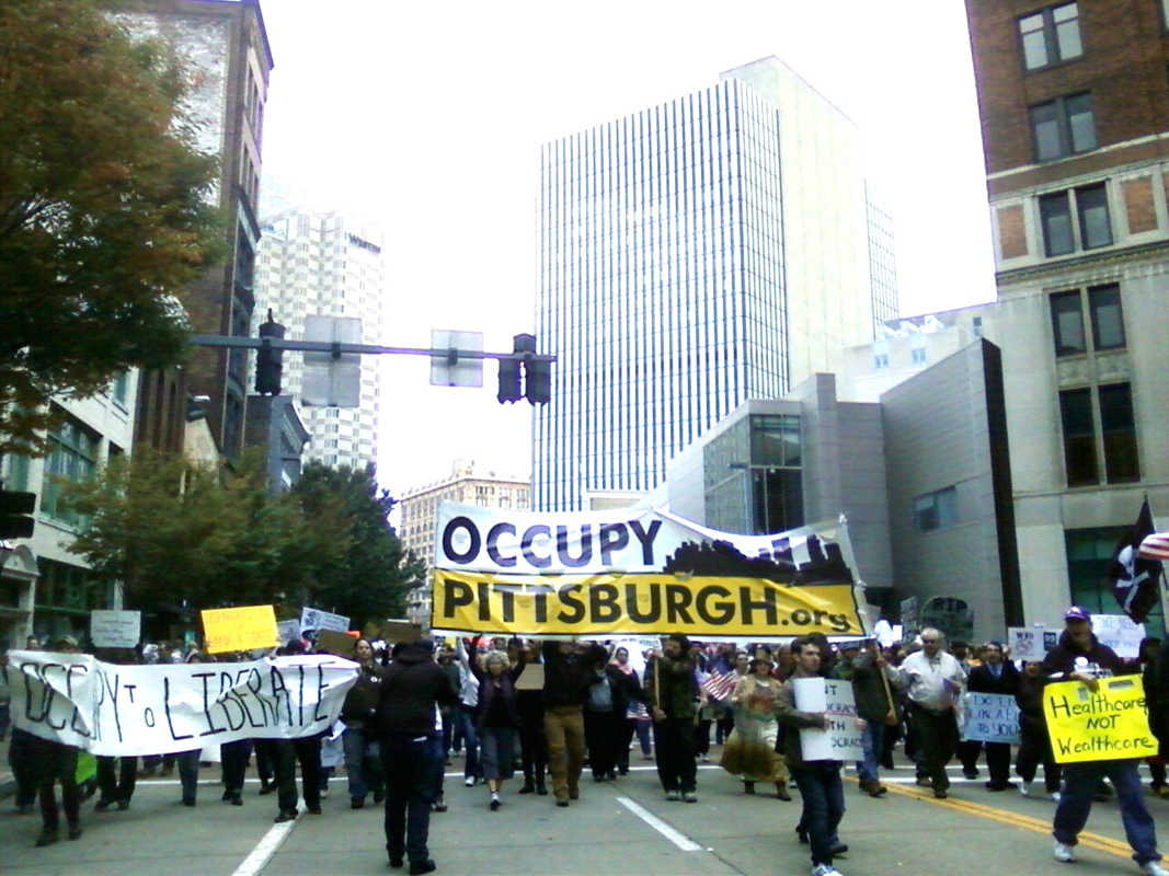 Anti-corporate protesters march through downtown Pittsburgh during Saturday's protest. (credit: Andy Peng/)