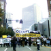 Anti-corporate protesters march through downtown Pittsburgh during Saturday's protest.