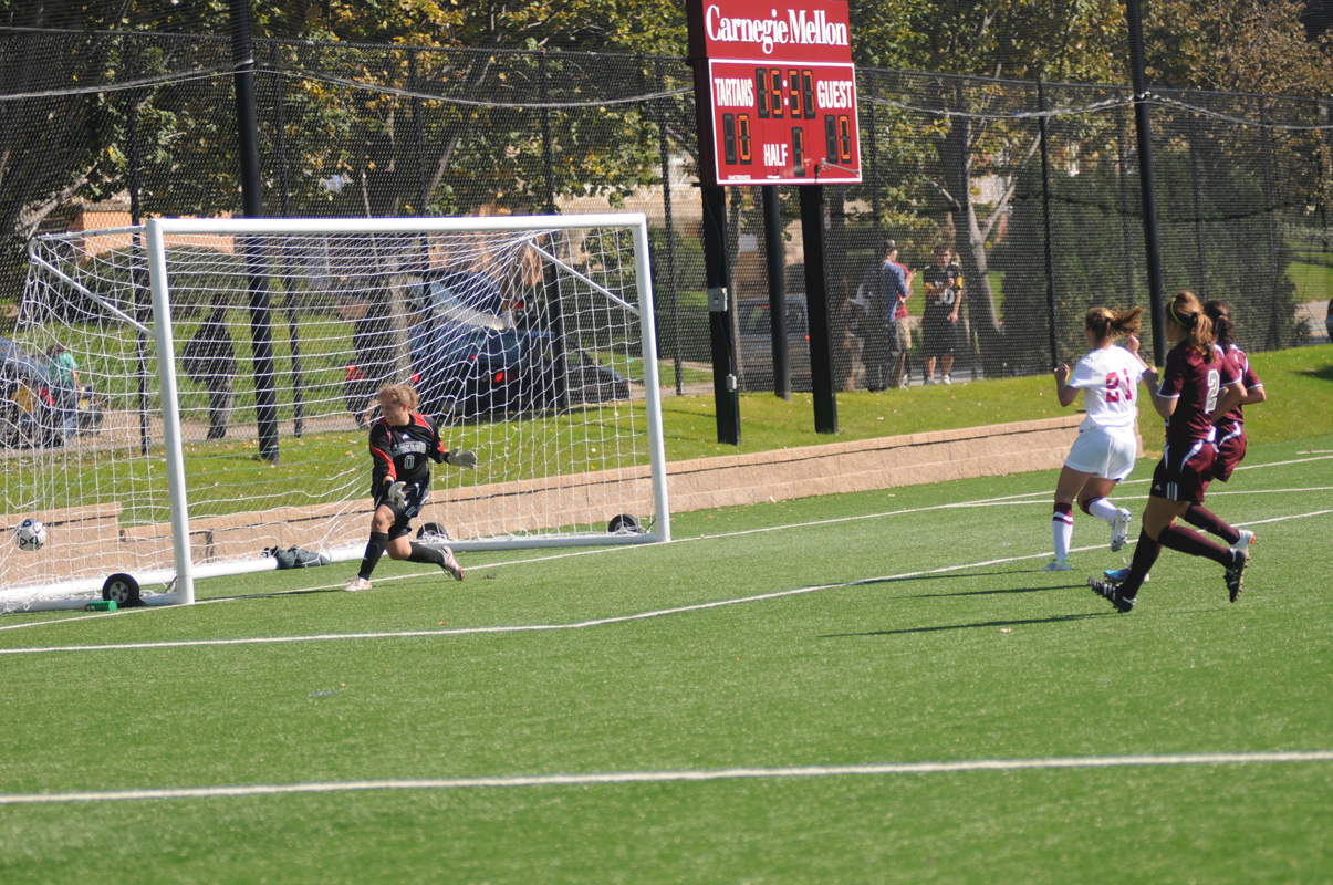 First-year Savina Reid scores a goal against the opposition's lockdown defense. (credit: Thomas Hofman/Photo Editor)